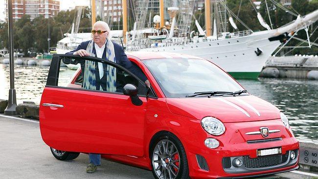 John Laws Captured with his Ferarri Fiat 500