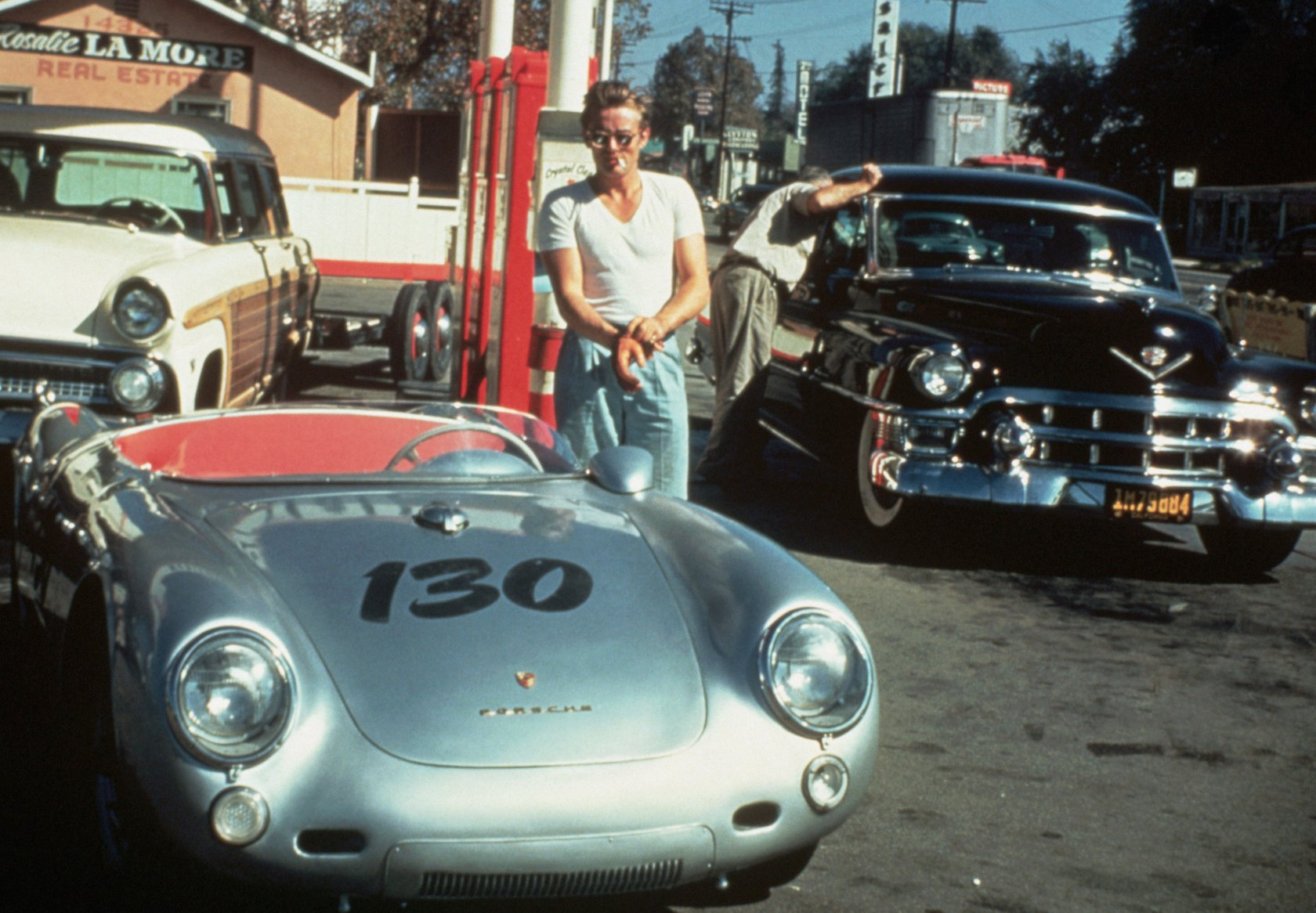 30 Sep 1955, California, USA --- James Dean at a gas station with his silver Porsche 550 Spyder he named Little Bastard, just hours before his fatal crash.